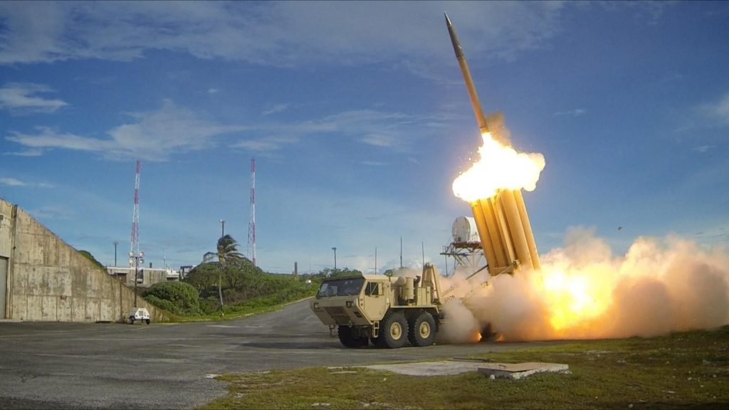 The first of two Terminal High Altitude Area Defense (THAAD) interceptors is launched during a successful intercept test. The test, conducted by Missile Defense Agency (MDA), Ballistic Missile Defense System (BMDS) Operational Test Agency, Joint Functional Component Command for Integrated Missile Defense, and U.S. Pacific Command, in conjunction with U.S. Army soldiers from the Alpha Battery, 2nd Air Defense Artillery Regiment, U.S. Navy sailors aboard the guided missile destroyer USS Decatur (DDG-73), and U.S. Air Force airmen from the 613th Air and Operations Center resulted in the intercept of one medium-range ballistic missile target by THAAD, and one medium-range ballistic missile target by Aegis Ballistic Missile Defense (BMD). The test, designated Flight Test Operational-01 (FTO-01), stressed the ability of the Aegis BMD and THAAD weapon systems to function in a layered defense architecture and defeat a raid of two near-simultaneous ballistic missile targets