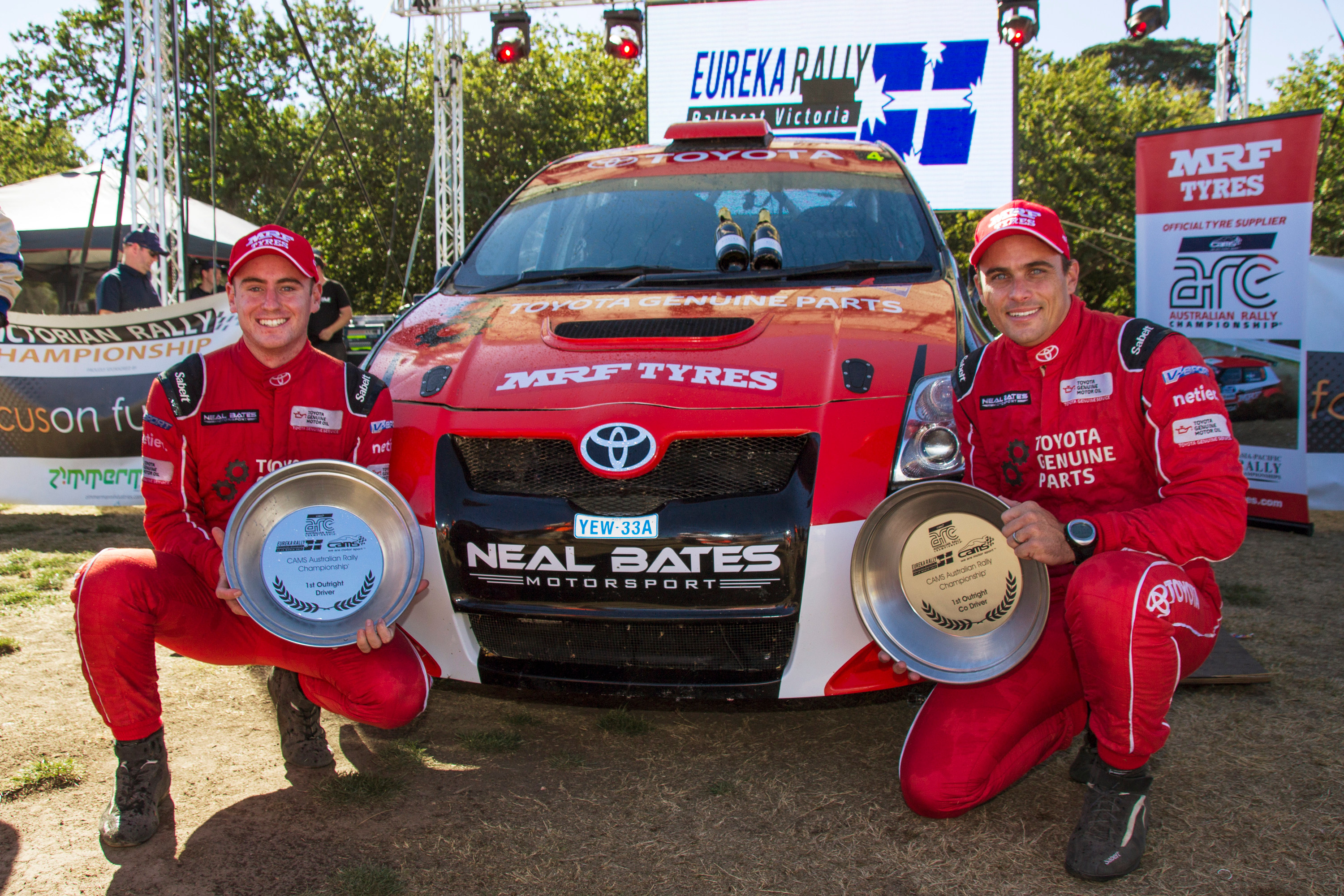 Harry Bates (left) and co-driver John McCarthy celebrate victory at the season-opening Eureka Rally.